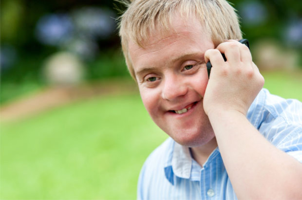 Boy with down's syndrome on the phone