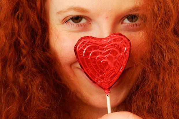 girl with heart lollipop