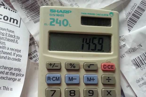 calculator surrounded by receipts