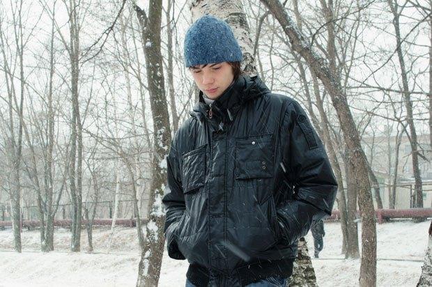 Boy sad in winter