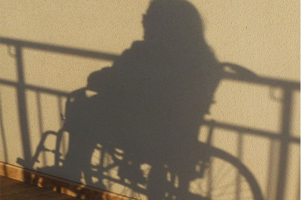 Shadow of a girl in a wheelchair