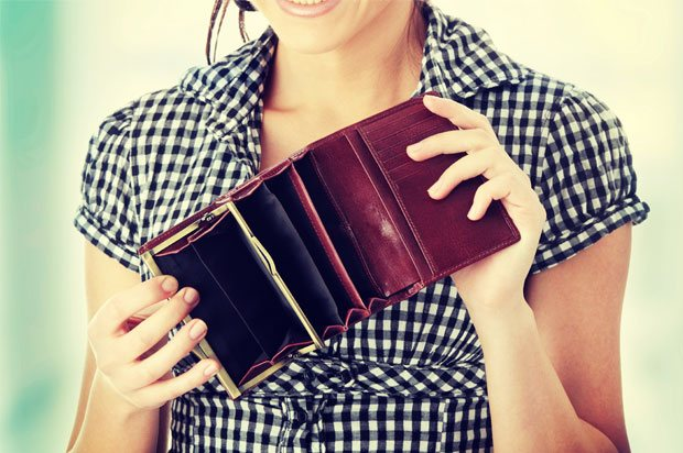 Woman showing empty purse