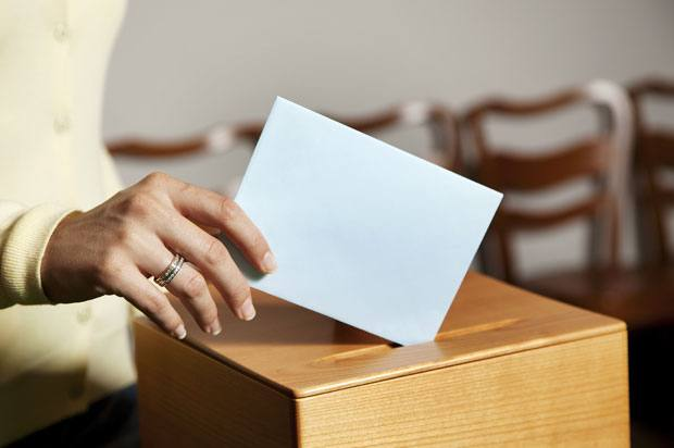 Woman using ballot box