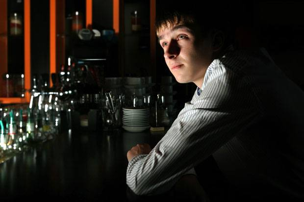 boy in dark bar