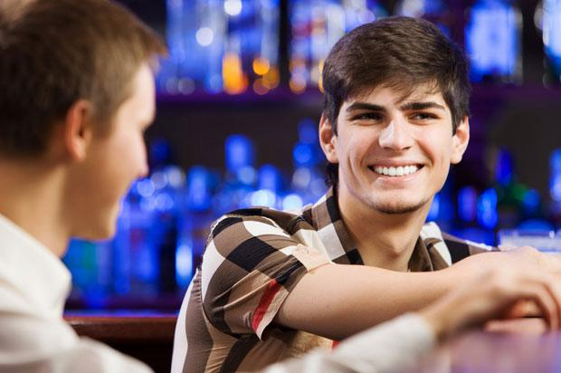 boy at bar with friend