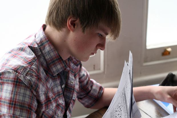 boy with papers