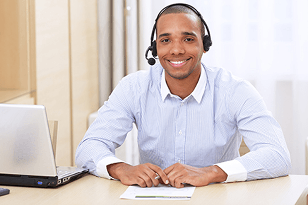 smiling guy in a call centre