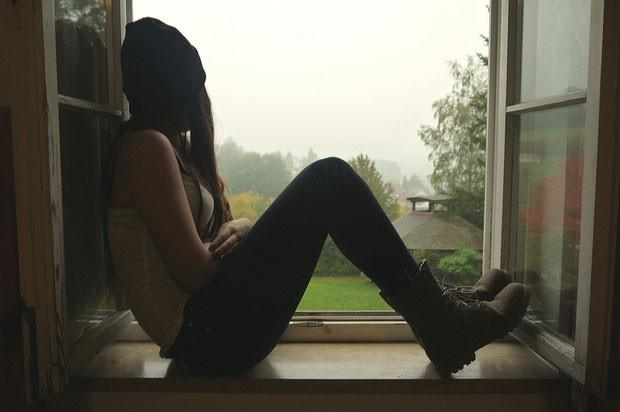 sad girl in window