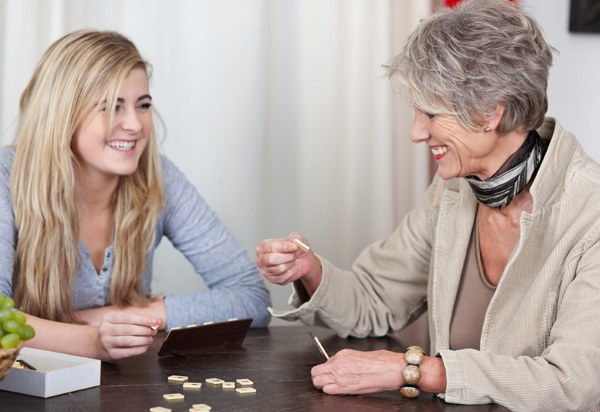 teenager and granny playing scrabble