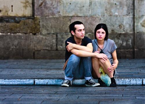 couple looking worried on kerb