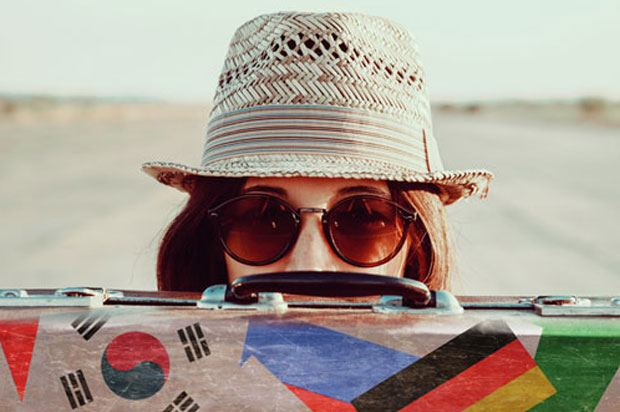 girl in shades with suitcase