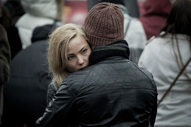 girl looking guilty in a hug