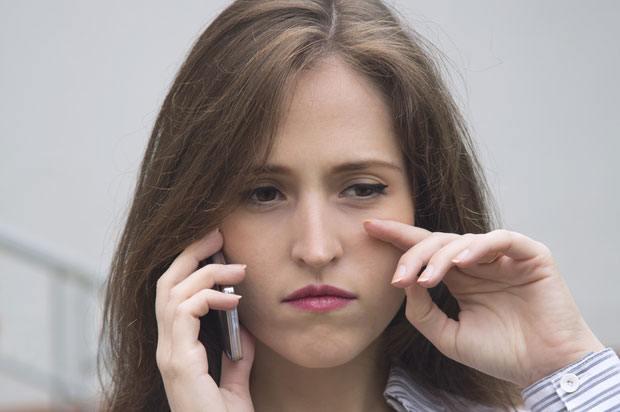 sad girl on phone