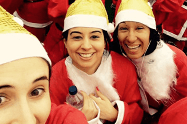 selfie of three women doing a santa run