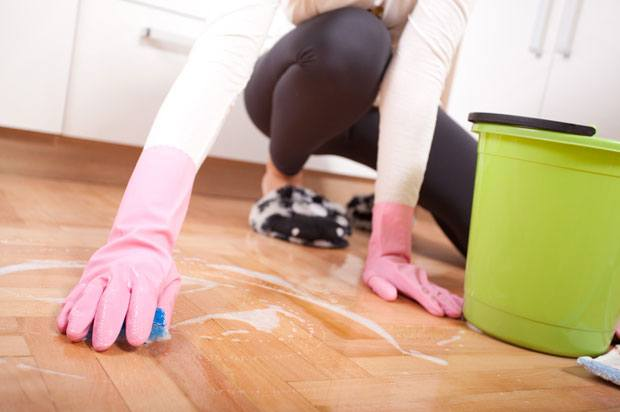 cleaning floor in rubber gloves