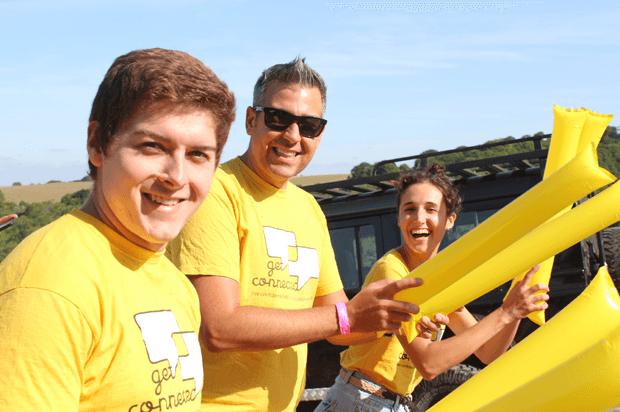 three volunteers cheering