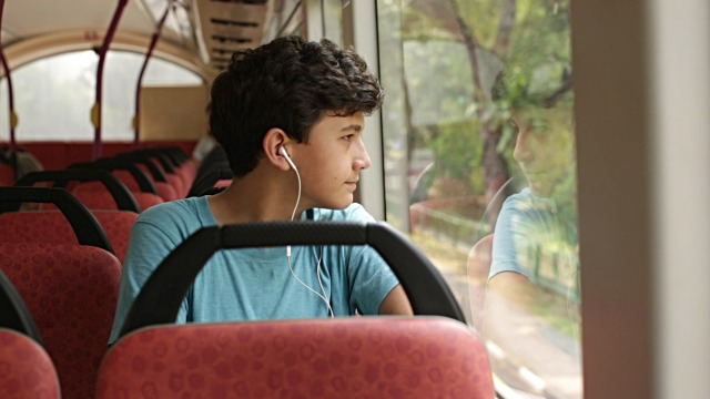 teenage boy on bus