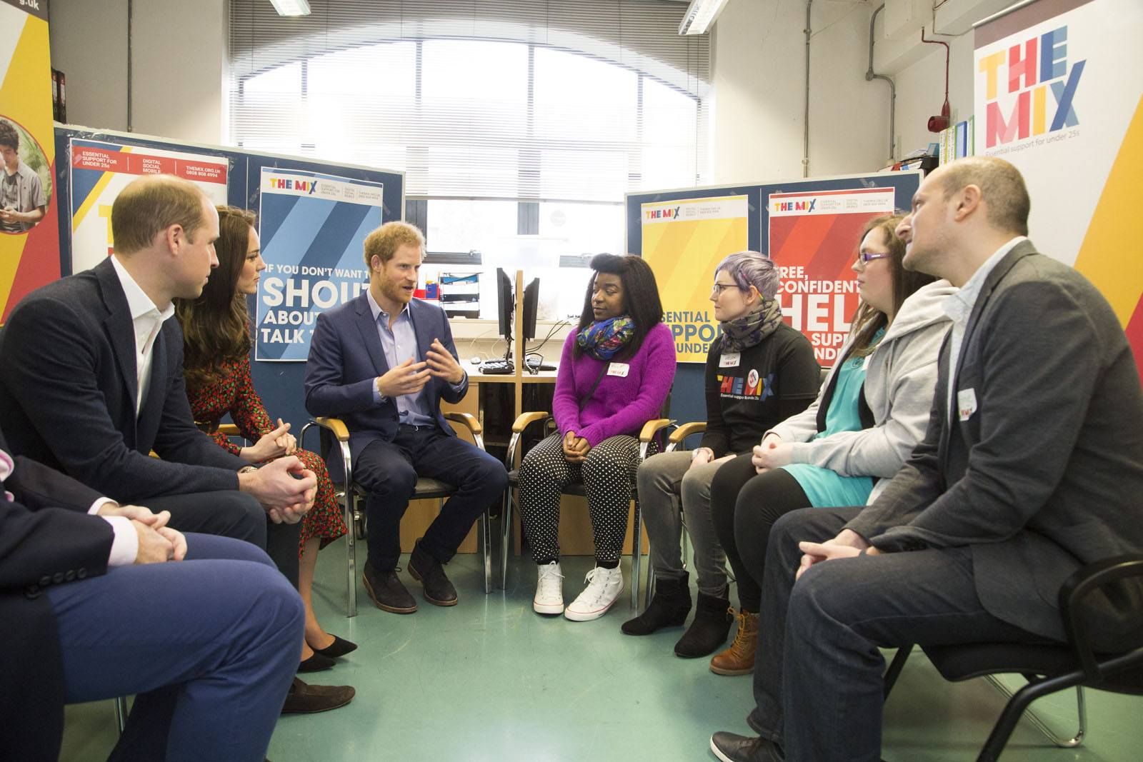 TRH The Duke and Duchess of Cambridge and Price Harry sit down to talk to members of The Mix's volunteer and staff team