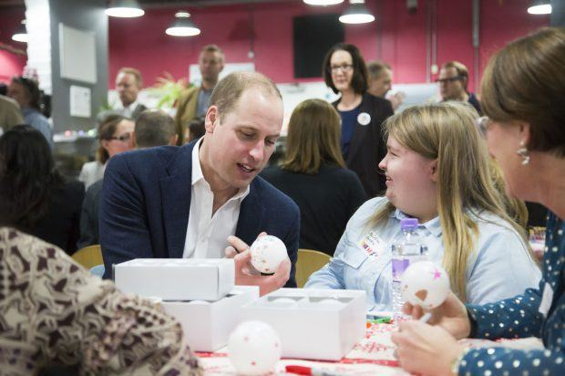 HRH The Duke of Cambridge talks with Jessica, one of The Mix's incredible volunteers
