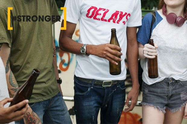 young people holding beers