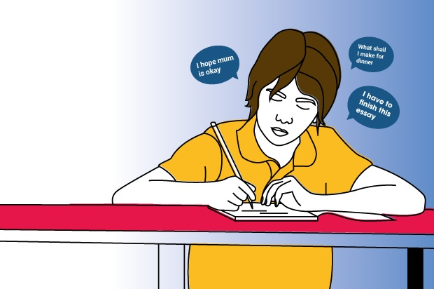 An illustration of a young carer in an orange shirt sitting at a pink desk with thought bubbles above their head