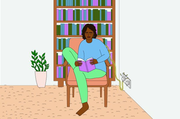 Illustration shows a young woman reading in a chair. She is wearing a blue top and green trousers and there is a charger plugged in behind her
