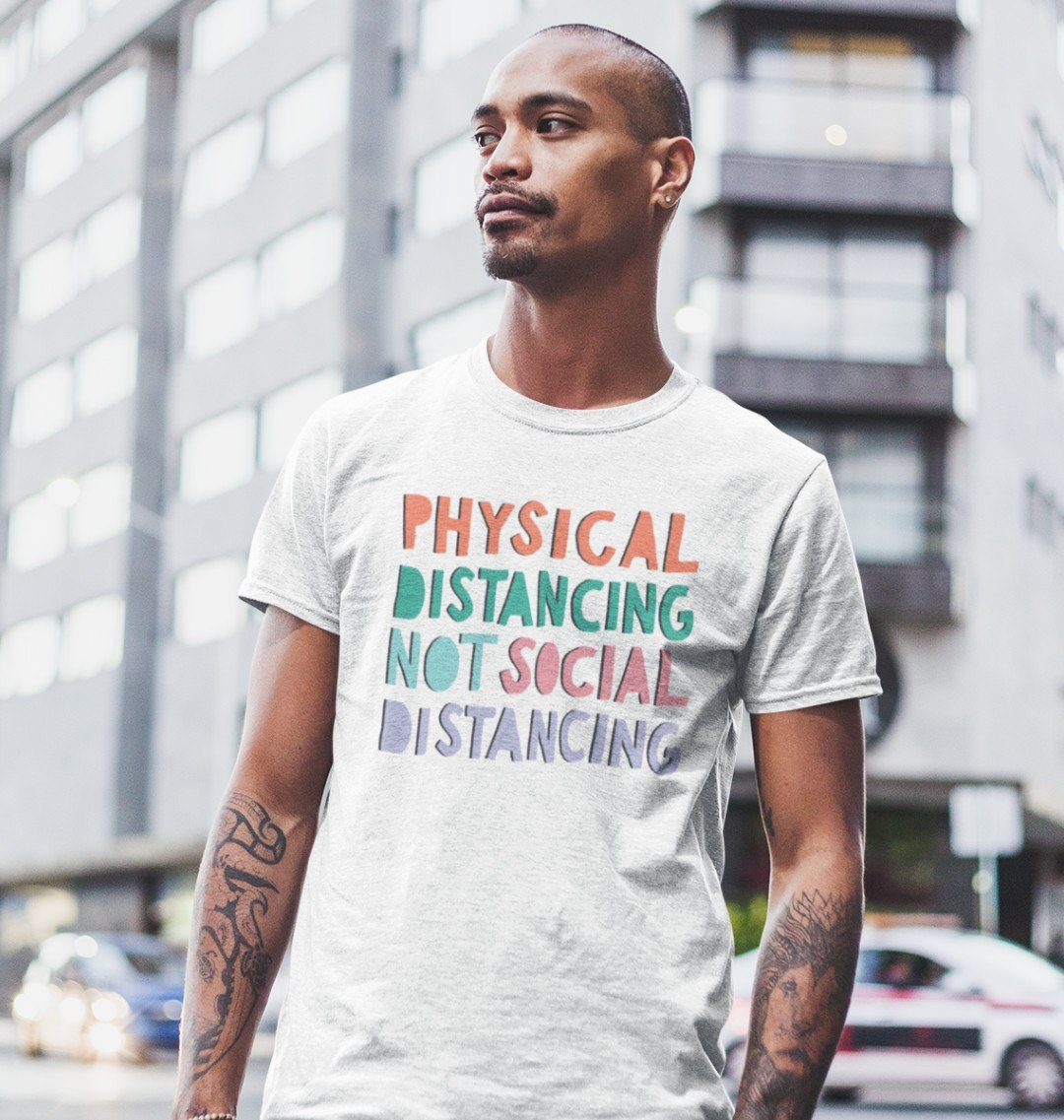 "A young man wears a Mix t shirt that reads: ""Physical distancing not social distancing"""