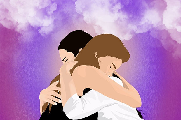 Two young people are hugging each other