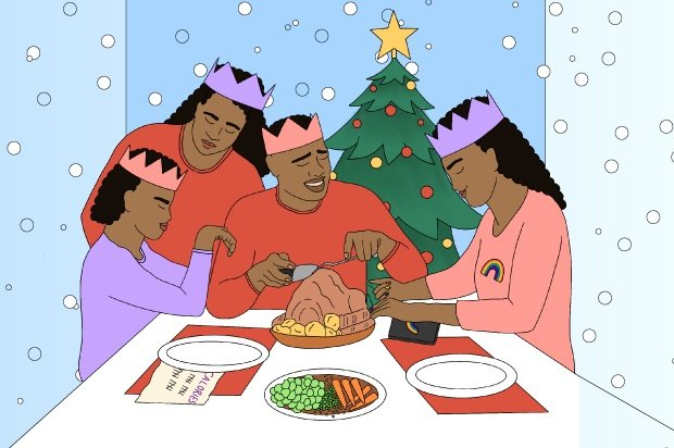 A family sits around a table eating at Christmas time